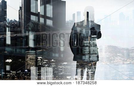 Businessman in big city . Mixed media
