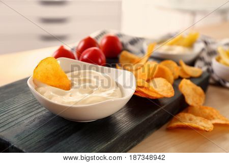 Composition with tasty mayonnaise sauce on kitchen table