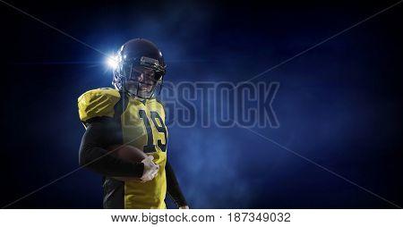 Football player on dark background. Mixed media . Mixed media