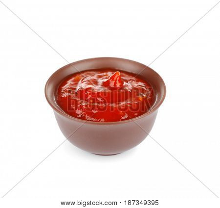 Bowl of delicious chili sauce isolated on white