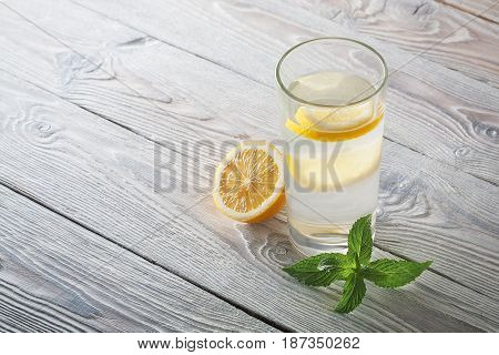 Lemonade Of Fresh Mint And Lemon On A Wooden Background