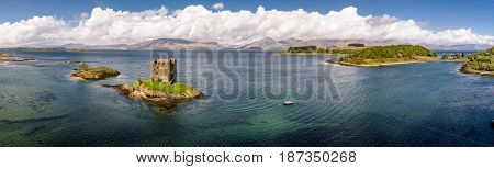 Aerial of the historic castle Stalker in Argyll, Scotland