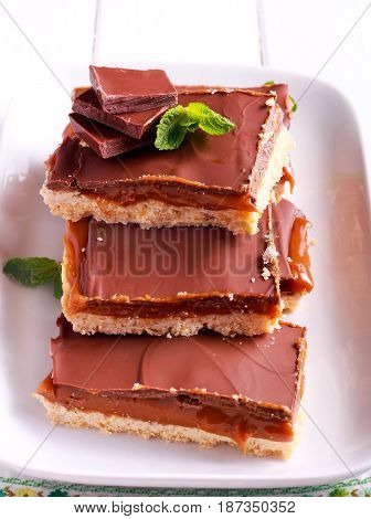 Millionaires' Shortbread - caramel and chocolate shortbread bars on plate