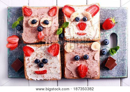 Kids sandwiches with cottage cheese and berries top view