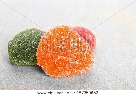 Tasty jelly candies on light background, closeup
