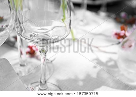 Wine glass on served festive table, closeup