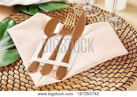 Table setting with pink color napkin and floral decor, closeup