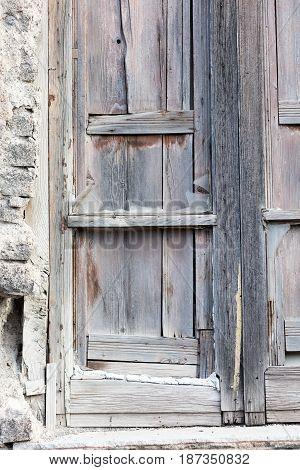Wooden broken window in the neighbourghs of Naples Italy