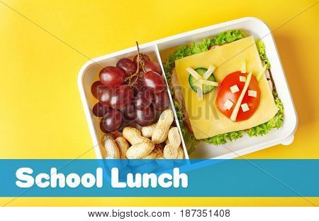 Concept of school lunch. Lunchbox and food on color background