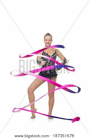 beautiful blond teen age gymnast girl making exercises with tape. Studio shot isolated on white background. Copy space.