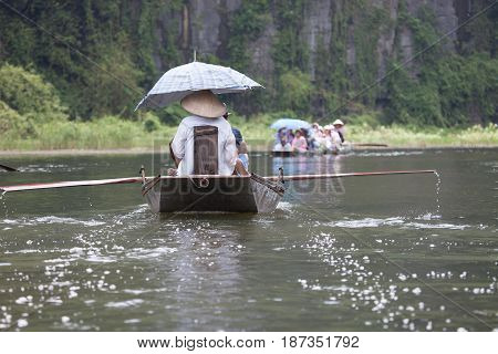 Boating on the Mekong Delta with concal hats Vietnam