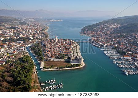 Trogir is a historic town and harbour on the Adriatic coast in Split-Dalmatia County Croatia The historic city of Trogir is situated on a small island between the Croatian mainland and the island of Čiovo.