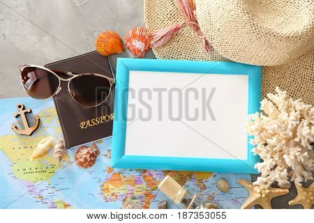 Travel concept. Composition with photo frame on gray background