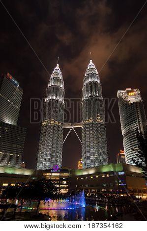 Petronas twin towers Kuala Lumpur Malaysia 10-09-2016. Low angle of the Petronas twin towers Kuala Lumpur Malaysia with fountain in the foreground.