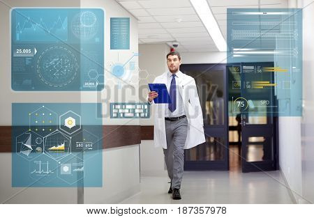 people, healthcare and medicine concept - doctor with clipboard walking along hospital corridor