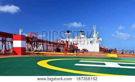 On deck a large crude oil tanker