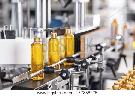 Factory And Research Concept. Bottles With Yellow Thick Substance Standing On Manufacturing Facility