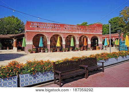 empty cafe in old building with colored umbrellas. Spain