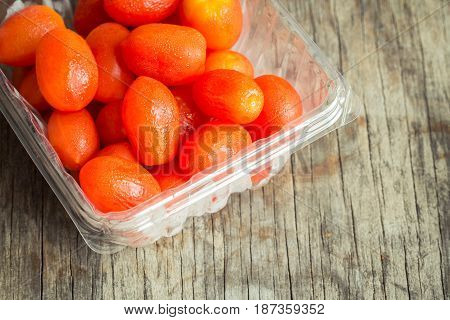 cherry tomato red color in water drops in plastic box
