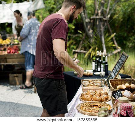 Customer Buying Fresh Baked Bakery at Food Stall