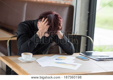Business Man Sitting In Depression With Hand On Head