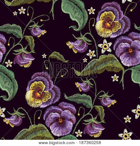 Violets flower embroidery seamless pattern. Classical embroidery beautiful flowers of violet on black seamless background. Fashionable template design of clothes