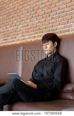 Business Man Using On Mobile Phone During Rest In Coffee Shop