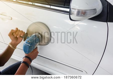 White car body color polishing by electric drill - auto body repair