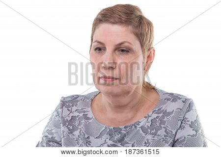 Portrait of puzzled old woman on white background