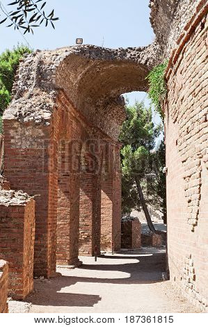 The ruins of the arch of the ancient greek theater in Taormina Sicily Italy