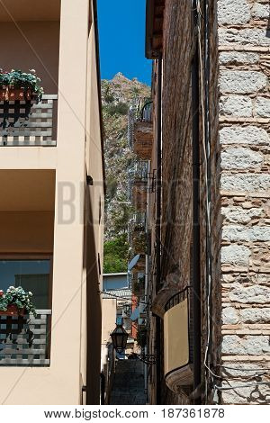 Alley in Taormina with the mountain on background Sicily Italy