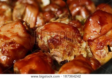 Roasted pork knuckles on a large frying pan