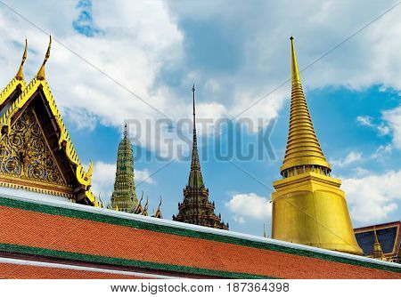 Wat Phra Kaew or the Temple of the Emerald Buddha as seen from the Outer Court, Bangkok, Thailand. The road along the temple walls