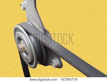 close up. car timing belt and pulley on yellow background with clipping path.