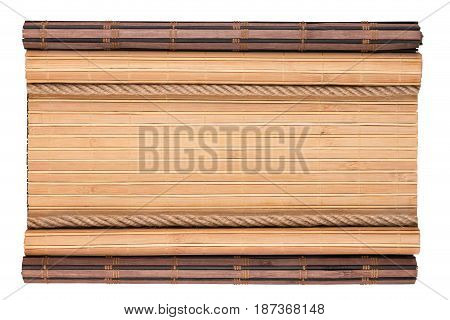 Bamboo mat with curled edges and rope isolated on white background. View from above