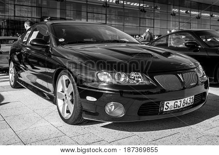 STUTTGART GERMANY - MARCH 04 2017: Muscle car Pontiac GTO (Fourth generation) 2006. Black and white. Europe's greatest classic car exhibition