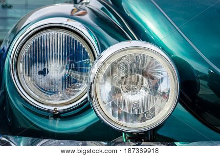 STUTTGART GERMANY - MARCH 04 2017: Headlamp of a compact car Volkswagen Beetle Cabrio 1976. Close-up. Europe's greatest classic car exhibition