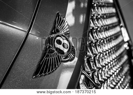 STUTTGART GERMANY - MARCH 04 2017: Hood ornament of large luxury crossover SUV Bentley Bentayga 2016. Black and white. Europe's greatest classic car exhibition