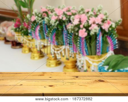 Empty wooden table space platform and blurred Engagement ceremony background for product display montage.