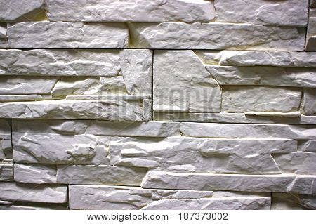 Stone masonry wall as background, stone  texture. gray shade of aging