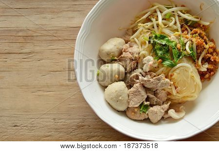 dried thin rice noodle with pork ball and boiled meat on bowl