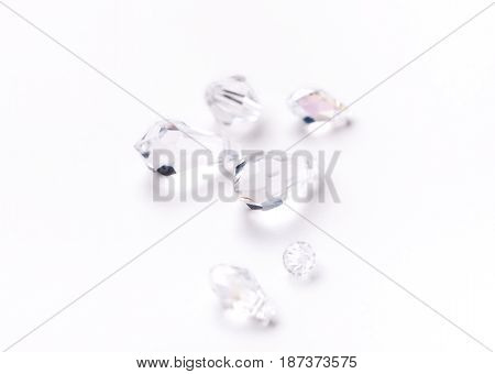 Shiny glass beads on white background close up. Jewelry, craft, bijouterie concept