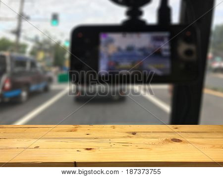 Empty wooden table space platform and blurred Camera recorder background for product display montage.