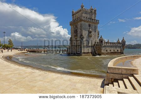 LISBON, PORTUGAL - MAY 11, 2017: People at the Belem Tower also known as the Tower of St Vincent. Since 1983, the tower is listed as UNESCO World Heritage site