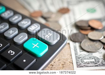 Closeup Of Calculator Plus Green Button With Money On Wood Board Economic Growth Concept.