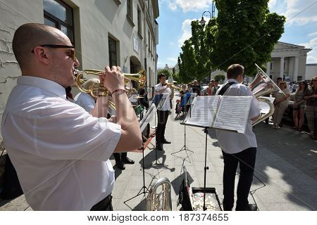 VILNIUS LITHUANIA - MAY 20: Unidentified musician play trumpet in Street Music Day on May 20 2017 in Vilnius. Its a most popular event on May in Vilnius Lithuania