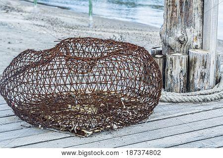 Drift net fishing net on wooden background. Closeup shot.