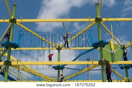 Jenkinson's Pavilion Point Pleasant NJ USA -- May 14 2017 --People climbing along the ropes at Adventure Lookout an amusement park ride at Jenkinson's Pavilion. Editorial Use Only