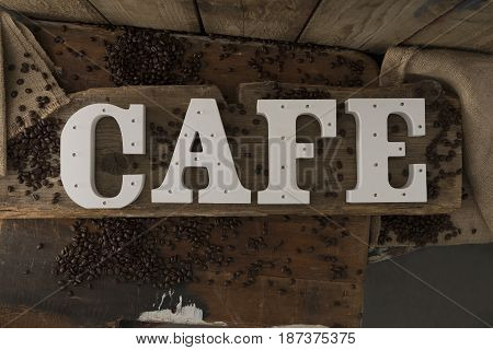 Letters With Led Lights Spelling Cafe On Wooden Surface