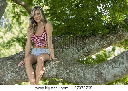 A young brunette model enjoying a day at the park.